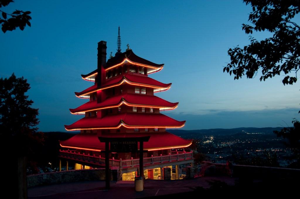 reading pagoda lit up at night
